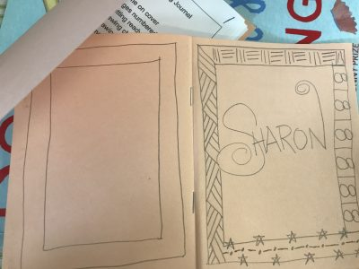 cover with name and frame with repeating patterns